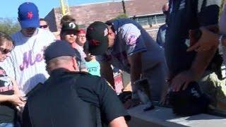 Tim Tebow Prays Over Fan Who Appears To Have A Seizure